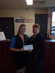 Band Secretary Heather McMillan accepts the cheque for $1000 on behalf of the band.